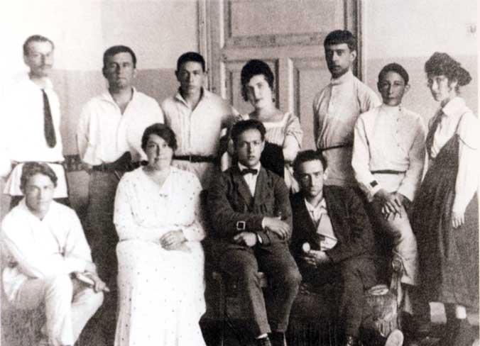 UNOVIS group. Vitebsk. 1922. Left-to-right, standing: I.Chervinko, K.Malevich, T.Royak, A.Kagan N.Suetin, L.Yudin, E.Magaril; seated: M.Vexler, V.Ermolaeva, I.Chashnik, L.Khidekel.
